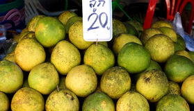 Cheaper by the Dozen# 2. Pomelos for sale in a roadside market in Thailand Royalty Free Stock Photography