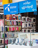 Cheaper phone calls in Myanmar. Yangon, Myanmar - October 15, 2014: Mobile phones and SIM cards have until recently been very expensive in Myanmar, but after Royalty Free Stock Photography