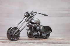 Cheaper vintage. Cool gift Bike various metal parts on wooden background Royalty Free Stock Image