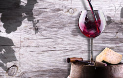 Chease, corkscrew and wine glass on a wooden vintage barrel Stock Photos