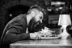 Cheat meal concept. Hipster hungry eat pub fried food. Manager formal suit sit at bar counter. Delicious meal. Man. Received meal with fried potato fish sticks stock photo