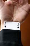 Cheater. Playing card, hand with an ace hidden in the arm stock image