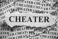 Cheater. Torn pieces of paper with the word Cheater. Black and White. Close-up stock photo