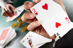 Cheating. While playing poker with hidden Ace under the sleeve Royalty Free Stock Image