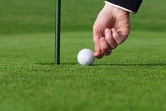 Cheating. Pushing the golf ball Royalty Free Stock Image