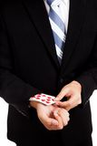 Cheating asian businessman pull playing cards from sleeve Stock Photography