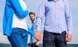 Cheating concept. Boyfriend full jealous looks aggressive cheaters couple. Man found or detected girlfriend cheating him. Walking with another man. Man royalty free stock photo