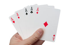 Cheating - Five Aces. This gambler is trying to cheat to win. For a game of five card poker, this hand has too many aces. The player is cheating, or the deck is Stock Photos