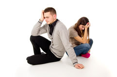 Cheating girl and a guy sitting in a quarrel Stock Photo