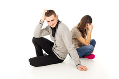 Cheating girl and a guy sitting in a quarrel  Stock Image