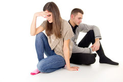 Cheating girl and guy sitting upset Royalty Free Stock Image