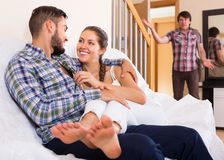 Cheating young spouse coming home. In wrong moment Stock Image