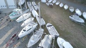 Chebeague Island, Maine - 20181006 - Aerial Drone - Fly Backwards Over Dry Dock Boats. stock video