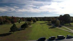 Chebeague Island, Maine - 20181006 - Aerial Drone - Fly Over Chebeague Inn Golf Fairway Over Parked Cars. Chebeague Island, Maine - 20181006 - Aerial Drone stock footage