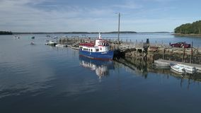 Chebeague Island, Maine - 20181005 - Aerial Drone - one quarter orbit starboard over Chebeague island ferry. stock footage