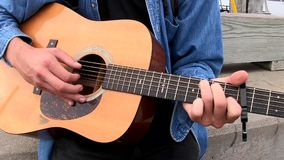 Chebeague Island, Maine - 20181007 - Closeup of Hands Playing Acoustic Guitar. stock video footage