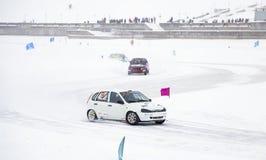 CHEBOKSARY, RUSSIA - JANUARY 28, 2018: Winter auto show - ice race. car rally on frozen lake. Speed auto racing on ice Stock Photo