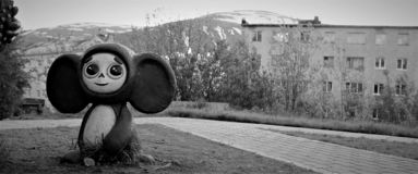 Cheburashka on the background of mountains stock images