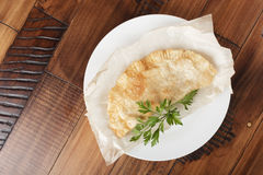 Cheburek with meat. On white plate. chiburekki - traditional asia kitchen. wooden background Stock Photography