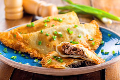Chebureki on a plate, meat pastry. Stock Photo