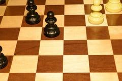 Chechered board under white chessmen like a sport backdrop stock photo