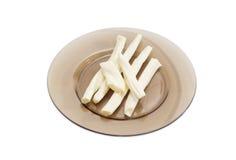 chechil乳酪的棍子在玻璃盘的 库存照片