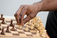 Chechmate chess player placing his pawn. This player to chechmate places his token to bar the way to his opponent Stock Photos