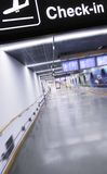 Check in. Airport terminal corridor with check in banner Royalty Free Stock Photography