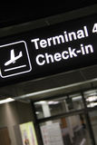 Check in. Airport terminal corridor with check in banner Royalty Free Stock Image