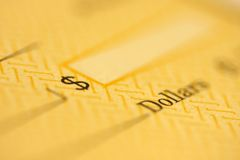 Check. Soft focus on dollar amount part of a paper check Royalty Free Stock Photo