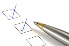 Check. Silver and gold ballpoint marking ticks in boxes.  Lots of copy-space Royalty Free Stock Image