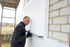 Check. To accuracy of the installation polystyrene plates Stock Photo