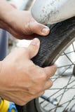 Check air pressure of wheel Stock Photo