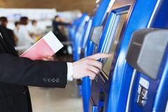 Check-in at the airport. Check-in at self help desk in the airport Royalty Free Stock Image