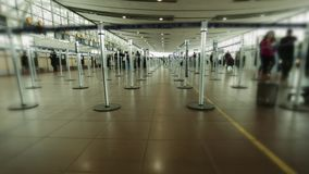 Check-in area at airport terminal with no lines, only several people walking around. Royalty Free Stock Photos