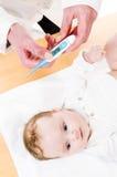 Check babys body temperature Royalty Free Stock Photos