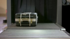 Check baggage at the airport x-ray scanner. Man traveler selective focus Baggage X-ray machine try to detection metal stock video