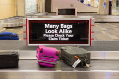 Check Baggage Warning Sign. A warning message displayed to travelers at an airport baggage claim area Royalty Free Stock Photos