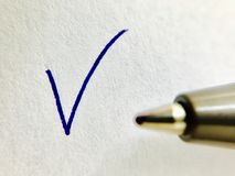 Check - ballpoint pen and checkmark Royalty Free Stock Image