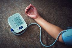Check blood pressure. And heart rate with digital pressure gauge standard blood pressure test results royalty free stock image