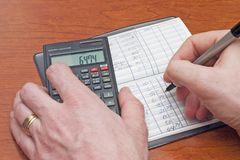 Check book. Being balanced with calculator Royalty Free Stock Photo