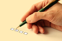 Check a box. Photo illustrate the concept of making a choice Stock Photo