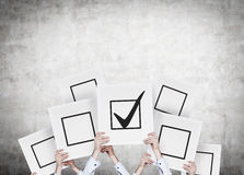 Check box. Hands holding poster with drawing check box Royalty Free Stock Photography