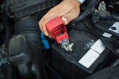Check the car battery polarity. At room Royalty Free Stock Images