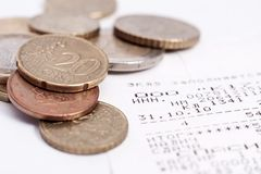 Check and coins Royalty Free Stock Photo