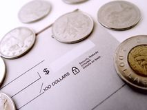 Check with Coins. All around it Royalty Free Stock Image