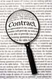 Check that Contract. Magnifying glass over contract document, highlighting the word contract.  Check that fine print Stock Image