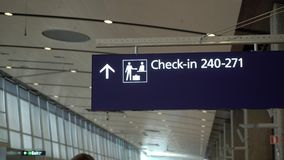 Check in counter in airport. Information sign stock video