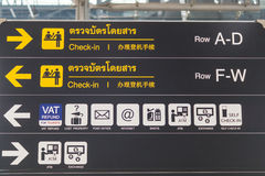 Check-in counter signs at departure terminal in international airport Stock Image