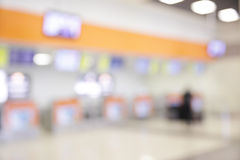 Check-in counters. In airport - bokeh background stock photography